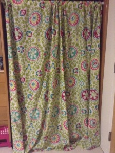 My wonderful work best friend, Sam, was great and helped me put this pretty curtain (shout-out to Mom for the find!) up over my closet.  I've got relatively pretty clothes, sure, but I'd rather not stare at them all of the time.